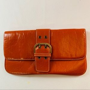 Shiraleah clutch purse rust colored with buckle